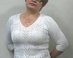 белый пуловер связанный ажурным узором
